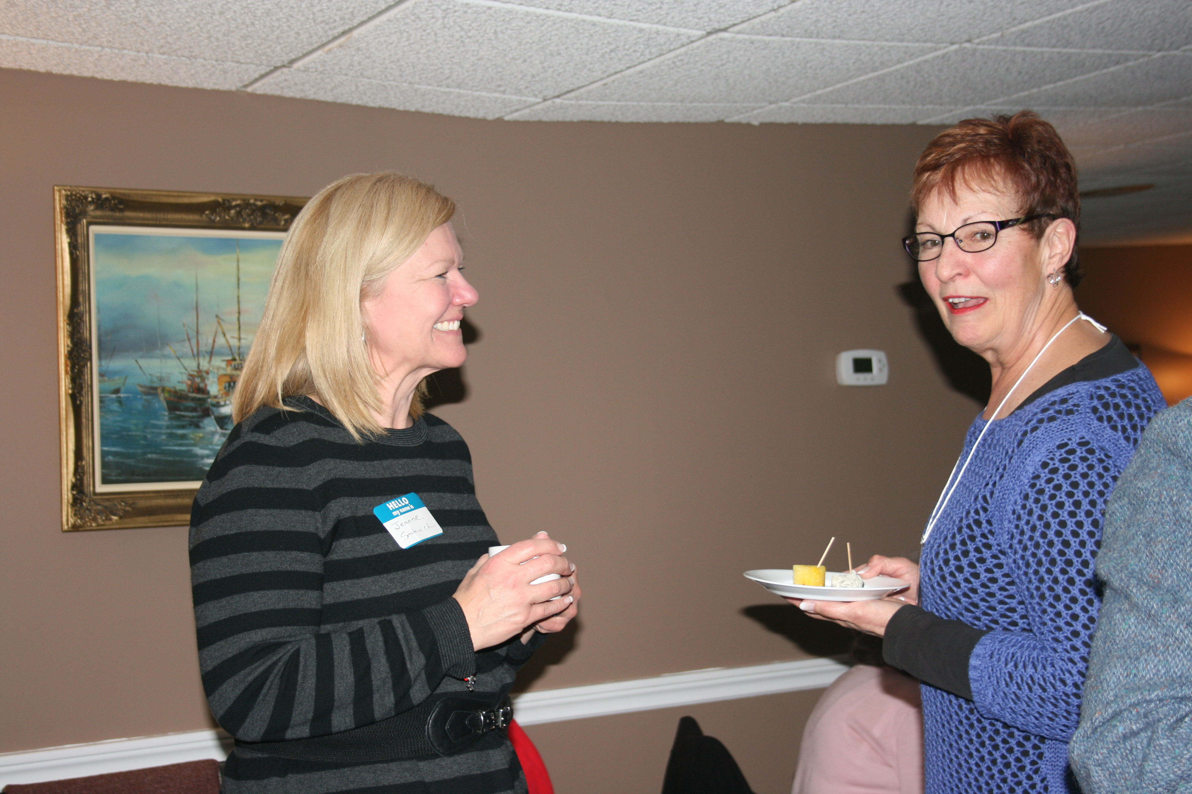 Members, Pat and Lin, sharing conversation and treats.